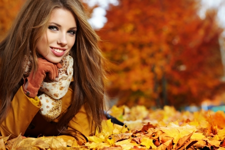 young woman portrait  in autumn park  photo