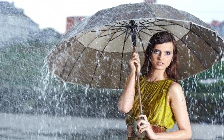 woman umbrella: woman in rain on street Stock Photo