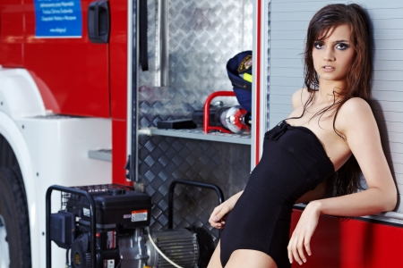 hot legs: Fashion woman in summer  body  and fire truck