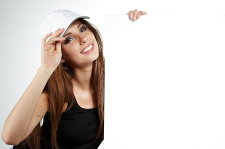 Sexy woman  holding a blank billboard   photo