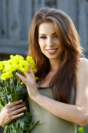 Woman holding yellow flowers . outdoor shoot Stock Photo - 14781033