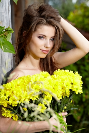 Woman holding yellow flowers . outdoor shoot Stock Photo - 14781024