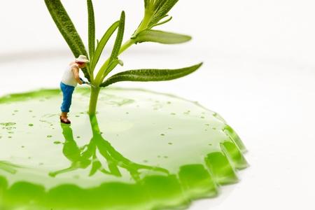 Miniature World. Gardener working on macro land photo