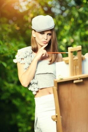 painter girl: Fashion woman is painting. Open air session.