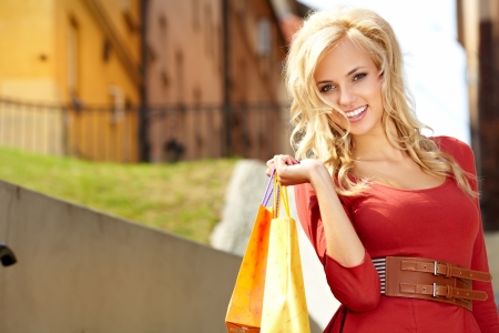 blond woman with many small shopping bags  photo