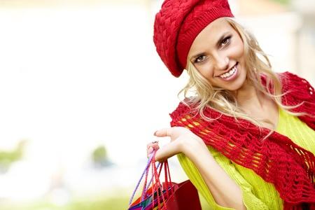Beautiful blonde shopping woman  outdoor photo