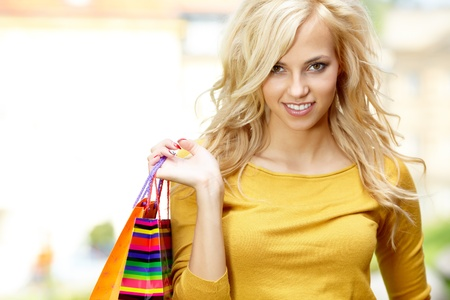 Smiling girl with shopping bags  photo