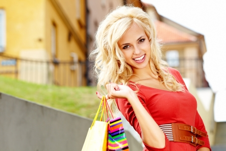 Happy young woman shopping  Stock Photo - 15040542