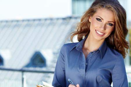 реальный: Attractive  Real Estate Agent Woman