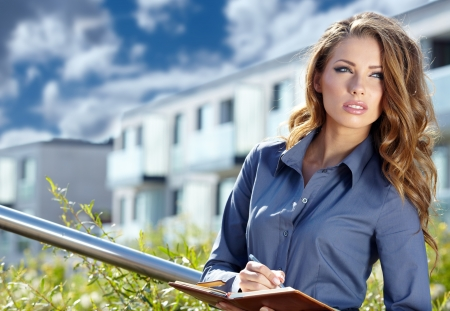 Beautiful young businesswoman among the constructions of the modern building Stock Photo - 15040504