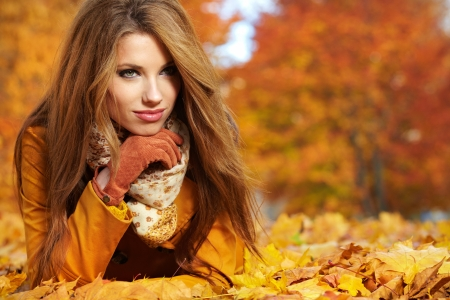 jungle girl: Beautiful elegant woman standing in a park in autumn