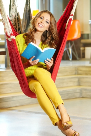 Young beautiful student girl  in hammock photo