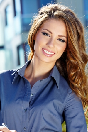 beautiful smile: Portrait of pretty young business woman smiling