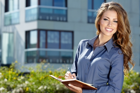 agents: Beautiful business woman on the background of the modern office