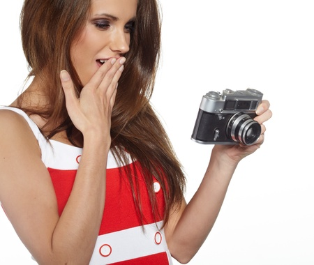 slr cameras: isolated studio picture from a young and beautiful woman with retro camera  Stock Photo