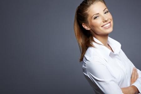 beautiful businesswoman portrait, gray background  Фото со стока