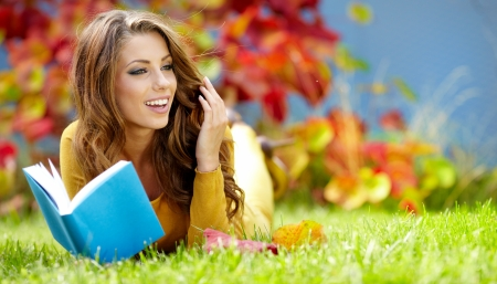 beautiful girl with book in the autumn park Stock Photo - 15153400