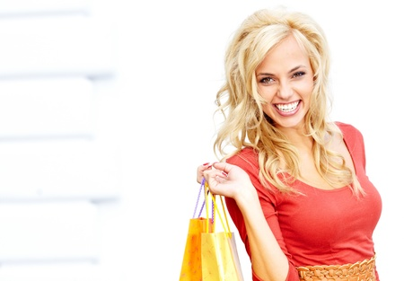 Happy young woman shopping Stock Photo - 15153344