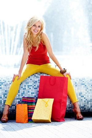 Happy young woman shopping Stock Photo - 15153378