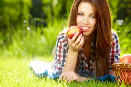 Beautiful woman in the garden with apples Stock Photo - 15153357