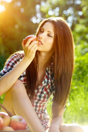 Beautiful woman in the garden with apples Stock Photo - 15153350