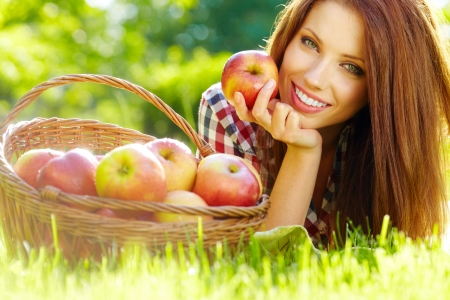 apples basket: Beautiful woman in the garden with apples