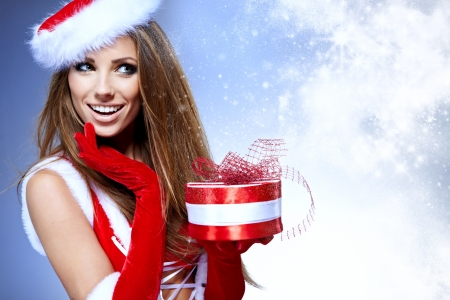 Beautiful young woman in Santa Claus clothes photo