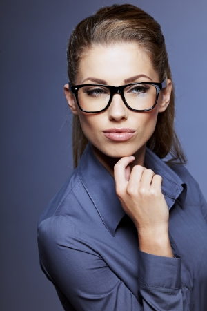 bussines: zakenvrouw in glazen Stockfoto