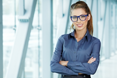 business woman holding glasses and looking at camera  Copy space  photo
