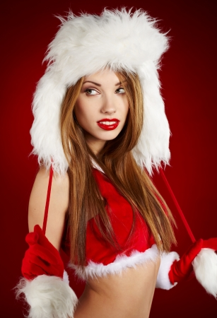 Beautiful and sexy woman wearing santa clause costume  Stock Photo - 15807039