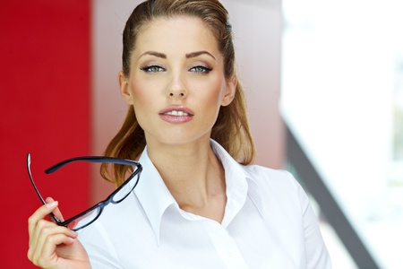 Beautiful business woman on the background of the modern office Stock Photo - 15714899