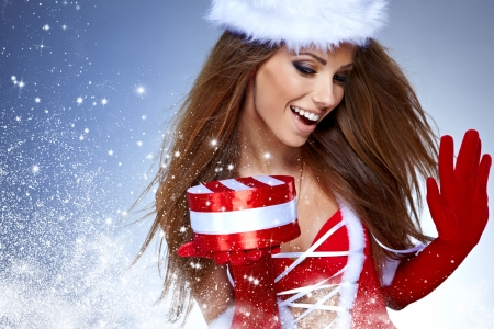 beautiful sexy girl wearing santa claus clothes  with christmas gift photo