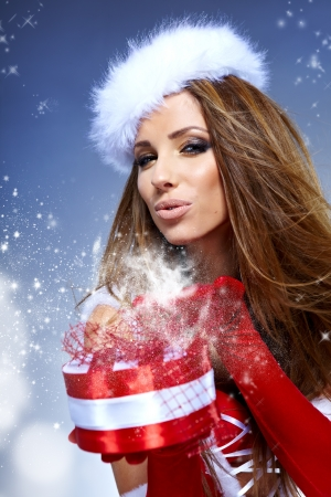 beautiful sexy girl wearing santa claus clothes  with christmas gift Stock Photo - 15807032