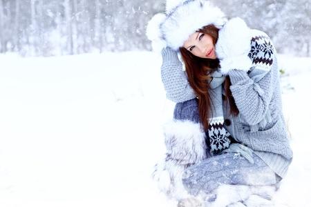 Beauty woman in the winter scenery  photo