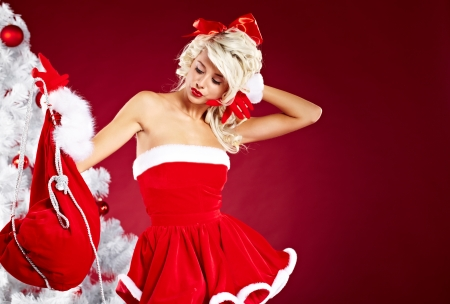 Pin-up sexy girl wearing santa claus clothes  photo