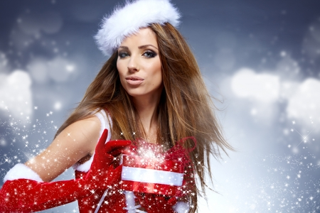 sexy christmas: beautiful sexy girl wearing santa claus clothes  with christmas gift