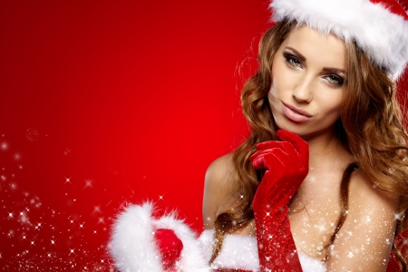 sexy santa: Portrait of beautiful sexy girl wearing santa claus clothes