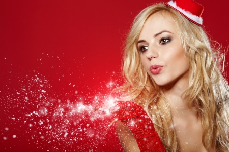 a fashion Christmas girl blowing snow   Stock Photo - 15940853