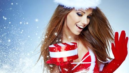 sexy santa: beautiful sexy girl wearing santa claus clothes  with christmas gift