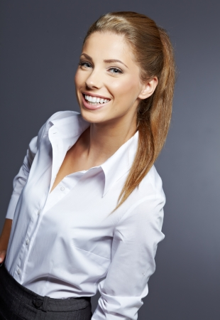 Portrait of young smiling businesswoman  Stock Photo - 16062113