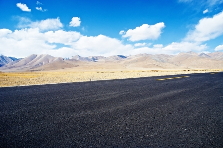 lofty: yellowish mountain road view in tibet of China  Stock Photo