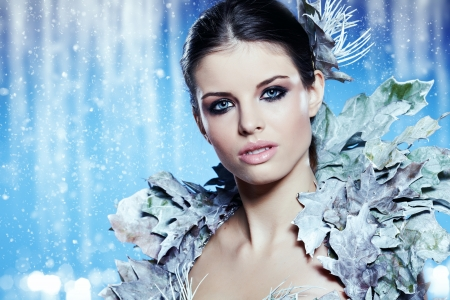 Young woman in creative image with silver artistic make-up. Stock Photo - 16118185