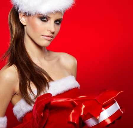Portrait of beautiful sexy girl wearing santa claus clothes  Stock Photo - 16038840