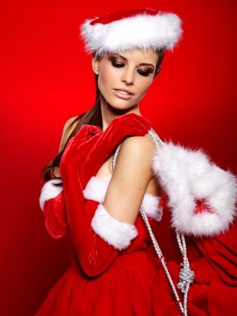 sexy santa: Portrait of beautiful sexy girl wearing santa claus clothes
