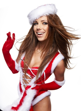 beautiful sexy girl wearing santa claus clothes with christmas gift  Stock Photo - 16038851