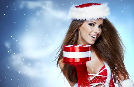 snow maiden: Santa girl on snow blue background  Stock Photo