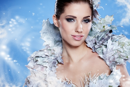 Young woman in creative image with silver artistic make-up.  Stock Photo - 16254392