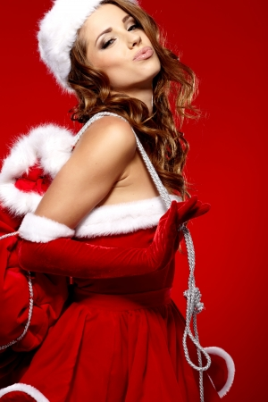 winter portrait of a santa woman with a christmas gift Stock Photo - 16333394