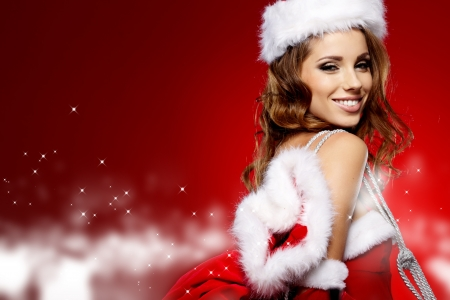 winter portrait of a santa woman with a christmas gift  Stock Photo - 16333383