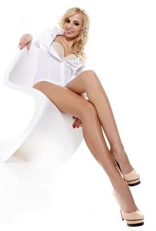 Attractive beautiful young blonde posing on a white  Stock Photo - 16333368